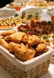 Puff pies in a basket on a buffet table Royalty Free Stock Image