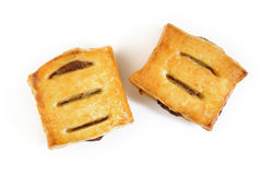 Puff pies with meat on white Stock Images