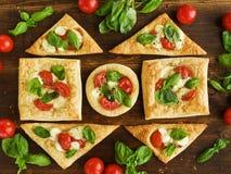Puff-pizzas Stock Photos