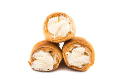 Puff rolls with cream. On white background royalty free stock photo