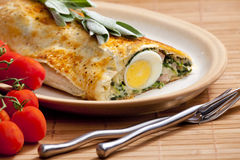 Puff roly-poly. Filled with spinach and eggs Royalty Free Stock Photos