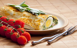 Puff roly-poly. Filled with spinach and eggs Stock Images