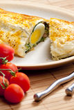 Puff roly-poly. Filled with spinach and eggs Royalty Free Stock Photography
