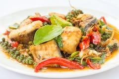 Puff savory fish kang put fresh green peppercorns on dish. Royalty Free Stock Images