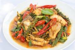 Puff savory fish kang put fresh green peppercorns on dish. Royalty Free Stock Photo