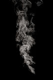 Puff of smoke. Abstract puff of smoke on black background Stock Photos