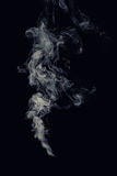 Puff of smoke. Abstract puff of smoke on black background Stock Images