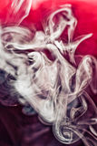Puff of smoke on red Royalty Free Stock Images