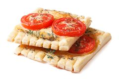 Puff tarts with tomato, cheese and thyme isolated Royalty Free Stock Photography