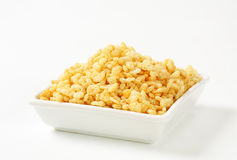Puffed cereal. Bowl of puffed cereal on white background stock photography
