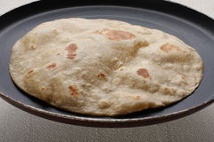 Puffed chapathi. Homemade fresh puffed  Hot Chapati in a pan Royalty Free Stock Photos