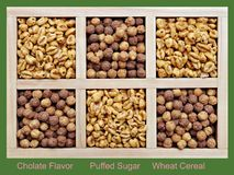 Puffed and chocolate flavor cereal. Puffed and chocolate flavor wheat cereal in wooden box Stock Images
