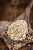 Puffed Quinoa (selective focus; close-up shot) on wooden backgro Royalty Free Stock Image
