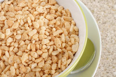 Puffed Rice Cereal. Rice and sugar paste that is formed into rice shapes royalty free stock images