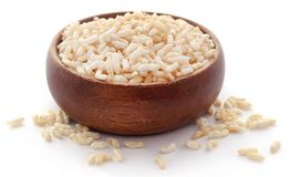 Puffed rice. In a bowl over white background stock photos