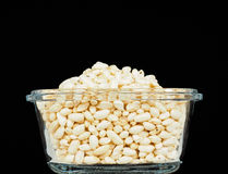 Puffed rice in translucent square glass bowl. Towards black Stock Photography