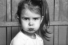 Puffed up girl. Small girl making faces Stock Photo
