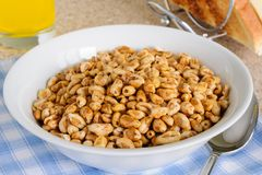 Puffed Wheat Cereal. Honey coated puffed wheat breakfast cereal stock photos