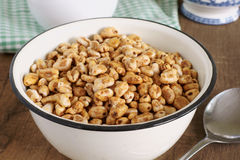 Puffed Wheat Cereal. Honey coated puffed wheat breakfast cereal royalty free stock images