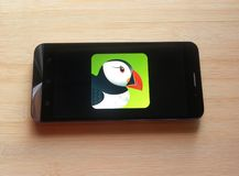 Puffin Browser app. On smartphone kept on wooden table stock image