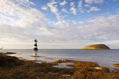 Puffin Island and Penmon Point lighthouse Stock Images