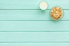 Puffins, corn cereals in bowls with milk on mint green wooden background top view space for text. Healthy breakfast. Puffins, corn cereals in bowls with milk on royalty free stock image