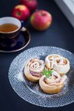 Puffs with apples and powdered sugar Stock Photos