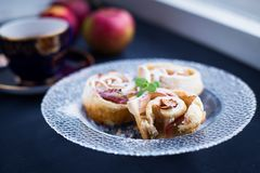 Puffs with apples and powdered sugar Stock Image