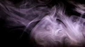 Puffs of smoke illuminated by colored light. Curls of colored smoke blurring against a dark background stock video