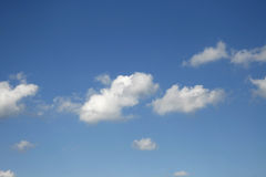 Puffy clouds. Puffy white clouds on a blue sky royalty free stock images