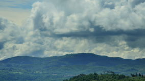 Puffy clouds above Tuscany hills stock video footage