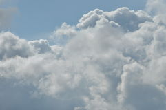 Puffy clouds against a blue sky. Beautiful Royalty Free Stock Images