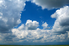 Puffy clouds background. Blue cloudy sky (could be used as background Stock Image
