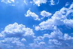 Puffy Clouds with blue background in summer Stock Photo