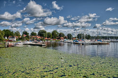 Puffy clouds, blue sky above a town on Malaren lake, Sweden Royalty Free Stock Photos