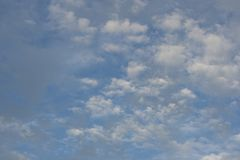 Puffy clouds and blue sky. Beautiful puffy clouds and blue sky Royalty Free Stock Images