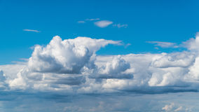 Puffy clouds on blue sky. Puffy clouds on deep blue sky Royalty Free Stock Photo