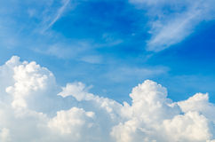 Puffy clouds and blue sky. In sunny day Stock Images