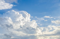 Puffy clouds and blue sky. In sunny day Royalty Free Stock Image