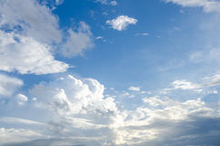 Puffy clouds and blue sky. In sunny day Stock Photography