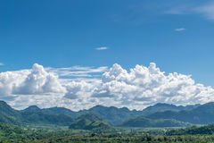 Puffy clouds and blue sky. In sunny day Royalty Free Stock Images