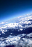 Puffy clouds with the brightly expressed atmospher. E  on height of 10 000 m above planet Earth Royalty Free Stock Photos