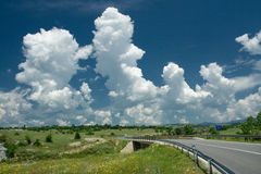 Puffy clouds in countryside stock photography