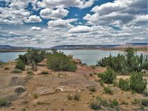 Puffy Clouds over Abiquiu Lake. Puffy clouds dot the sky above Abiquiu Lake and the mountains in northern New Mexico Royalty Free Stock Photos