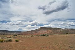 Puffy Clouds over Ghost Ranch. Puffy clouds fill the sky over the remote desert landscape of Ghost Ranch in northern New Mexico near Abiquiu Royalty Free Stock Photos