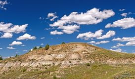 Puffy Clouds Over the Badlands. In Theodore Roosevelt National Park in North Dakota Royalty Free Stock Images