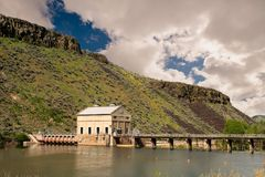 Puffy clouds over the Diversion dam on the Boise River. Historic diversion dam in the spring time along the Boise River in Idaho stock images