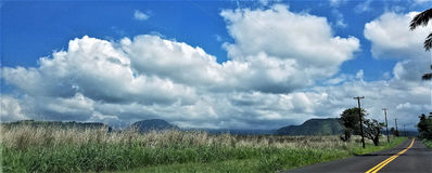 Puffy Clouds Over the Mountains and Field. In Naalehu, Hawaii on the Big Island Stock Photography
