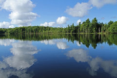 Puffy Clouds Reflected in Lake Stock Photos