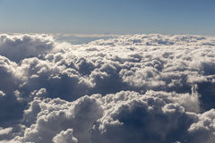 Puffy Clouds from Above. Puffy clouds seen from an airplane Royalty Free Stock Photos